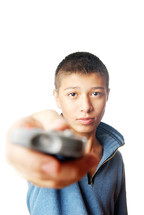 a boy holding a tv remote control