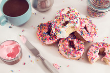 sprinkled donuts with pink icing
