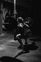 woman doing a back squat