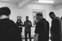 prayer during a men's group meeting