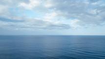 ocean water under a blue sky