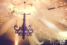 white tulle hanging from a chandelier
