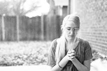 a woman praying outdoors