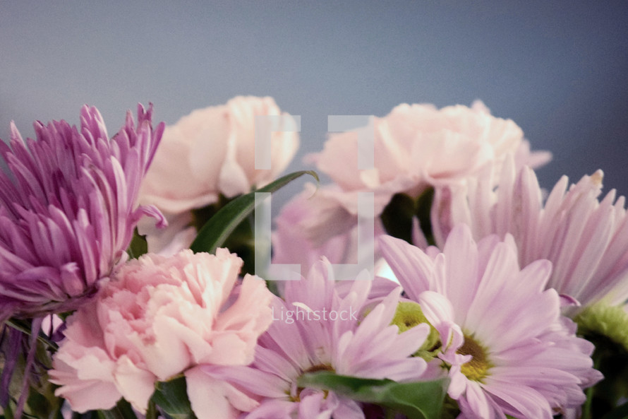 pink and purple flowers in a bouquet