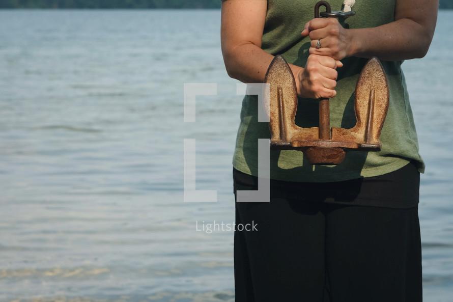 a woman holding an anchor