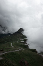 clouds covering a mountain
