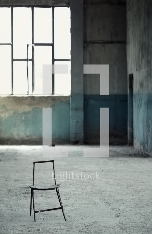 chair in an abandoned building