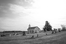 rural church surrounded by a cemetery