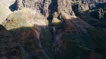 sunlight on rugged cliffs on a mountainous island landscape