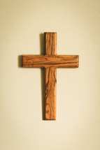 simple wooden cross hanging on a wall