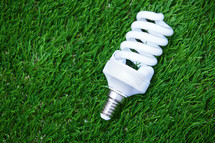 Energy saving bulb in the grass