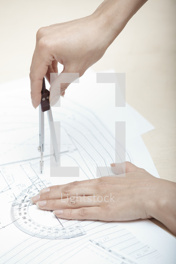 woman using a protractor