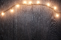 a string of lights on wood