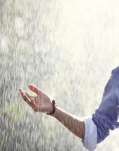 a man standing in rain