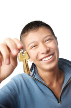Cheerful male with key from residential apartment