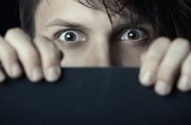 a peeking man
