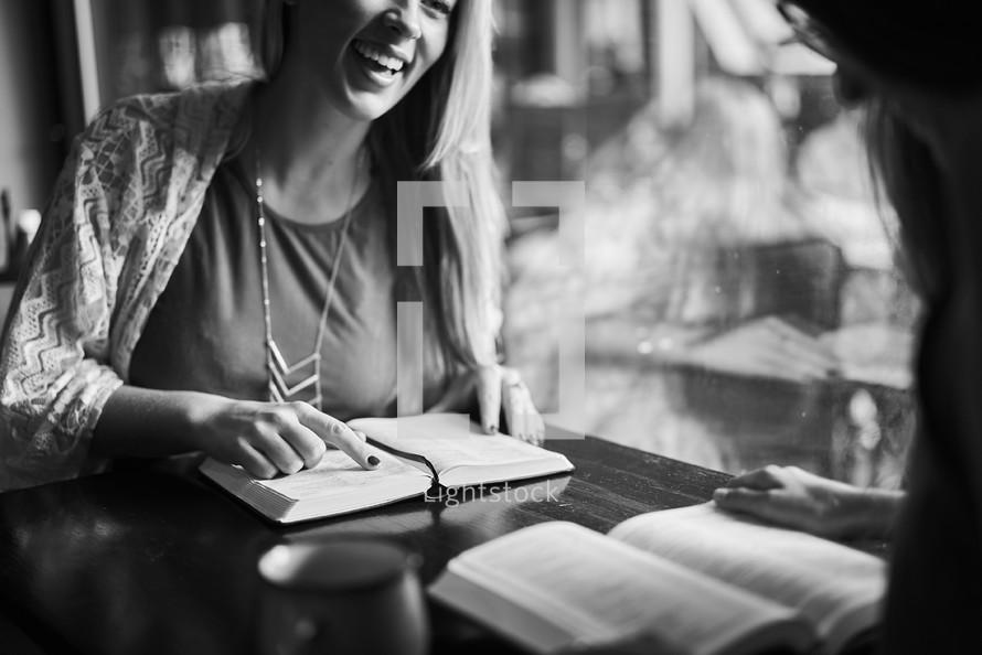 women discussing scripture