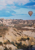 hot air balloons over a canyon