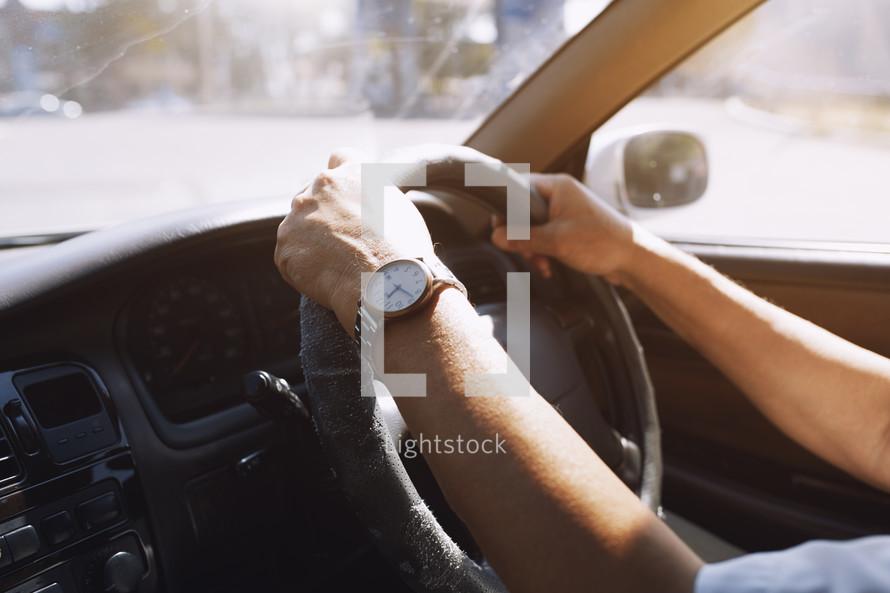 hands on a steering wheel in Europe
