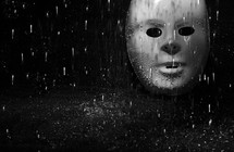 rain falling on a mask