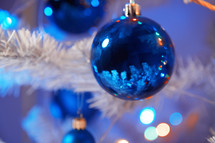 blue ornaments on a Christmas tree