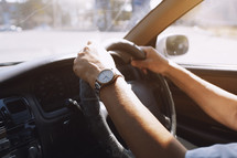 hands on a steering wheel in Europe