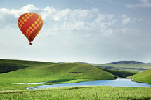hot air balloon over green grass