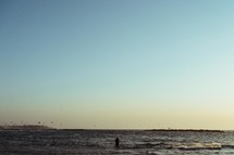 a man walking into the ocean