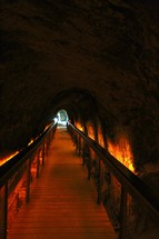 A walkway through an underground tunnel.