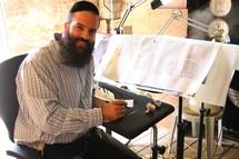 Rabbi hand-writing the Torah