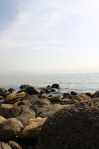 The rocky shore by the Sea of Galilee
