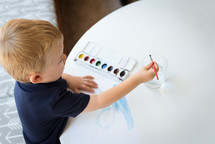 child painting with watercolors