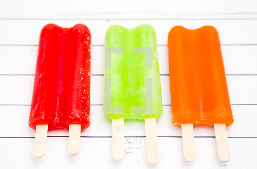 popsicles on a white background