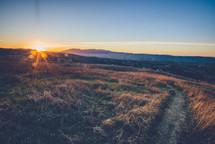 sunburst over a mountaintop at sunset