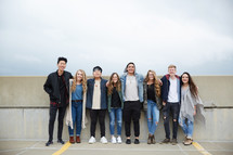 group of teens standing in a row