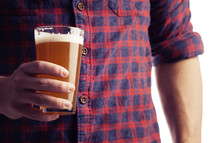 a man holding a beer glass
