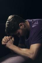A man kneeling in prayer