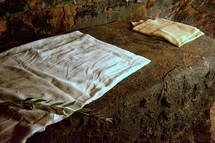 and the face cloth, which had been on Jesus' head, not lying with the linen cloths but folded up in a place by itself.