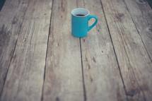 coffee mug on wood