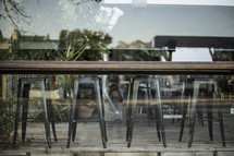 rows of stools in the window of a cafe