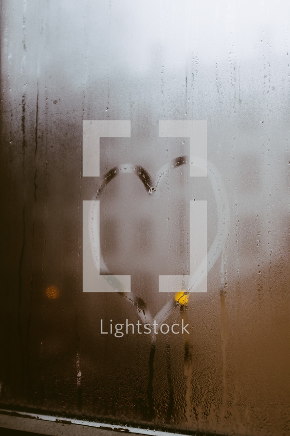heart on fogged up glass