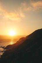 mountainous shoreline at dawn