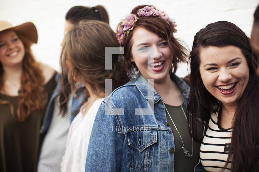 a group of smiling young women