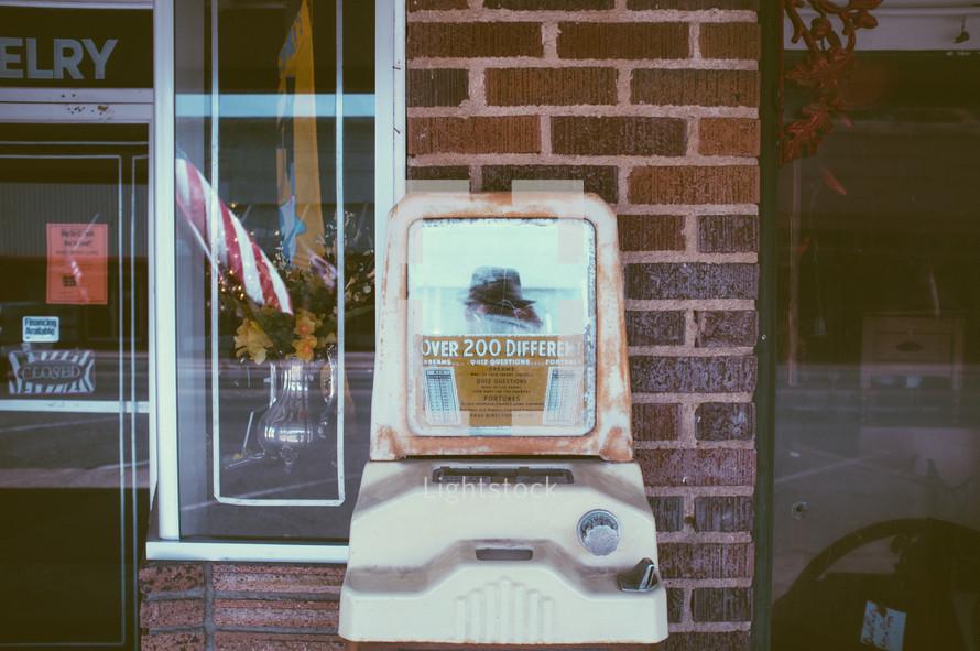 vintage quiz machine in front of an antique store