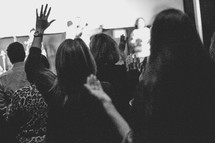 congregation with raised hands during a worship service