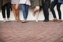 legs of a group of young women