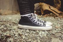 sneakers on rocks