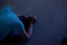Man kneeling.