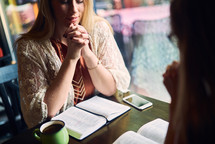 women at a Bible study praying