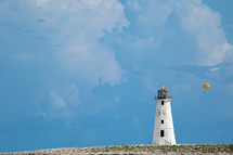 White Lighthouse and a parasail